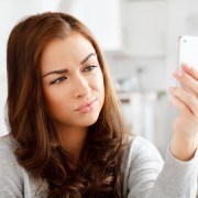 Pretty young woman dating over mobile phone