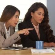 Multi-ethnic businesswomen working on laptop