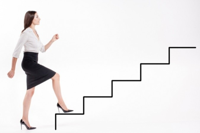 Young businesswoman walking up on corporate ladder