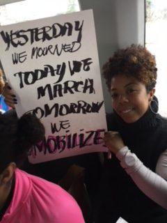 Tasha Warren holding our slogan sign Women's March on Washington