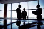 female leadership men in board room